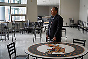 Quincy Natay, Superintendent of Chinle Unified School District stands for a portrait inside of the high school cafeteria. The faculty was recently renovated, but no students have been able to benefit from the update do to the COVID-19 pandemic,