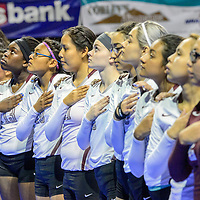The Ramah Mustangs align together for the national anthem before facing the Logan Longhorns in the 2A girls state volleyball final at the Santa Ana Star center in Rio Rancho Saturday.