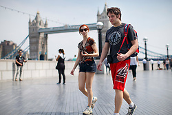 © Licensed to London News Pictures. 09/05/2016. London, UK. Tourists enjoy sunshine and warm weather near City Hall in London on Monday, 9 May 2016. Photo credit: Tolga Akmen/LNP