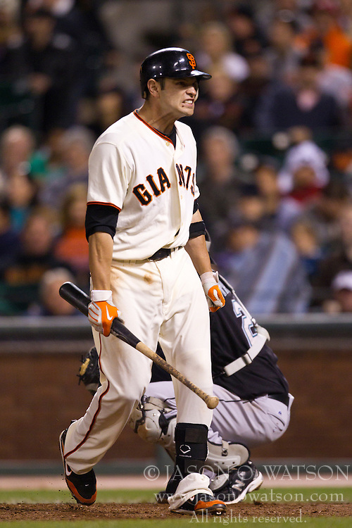 July 27, 2010; San Francisco, CA, USA;  San Francisco Giants second baseman Freddy Sanchez (21) reacts after striking out against the Florida Marlins during the seventh inning at AT&T Park. San Francisco defeated Florida 6-4.
