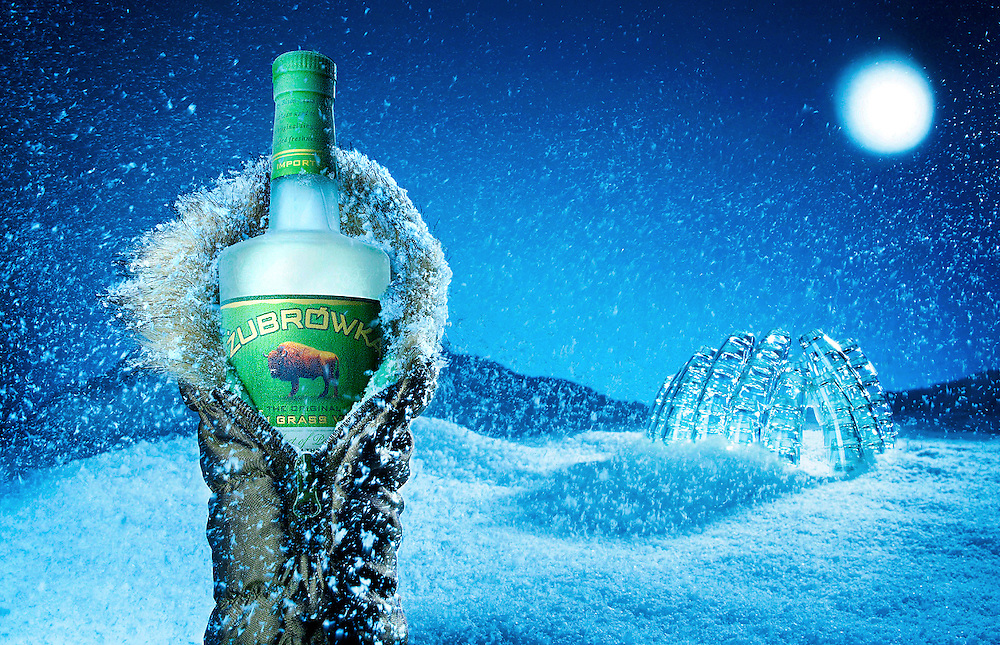 Bottle of Bison Grass Vodka in cold winter night with an igloo in the background.