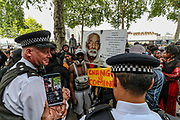 Protestors argue with policemen in front of New Scotland Yard, the headquarters of London's Metropolitan Police Service, after a rally at Downing Street in London, Tuesday, June 9, 2020. Anger against systemic levels of institutional racism has raged through the city, and worldwide; sparked by the death of George Floyd, who was killed in Minneapolis, US, by a policeman who restrained him with force on 25 May 2020. (Photo/ Vudi Xhymshiti)