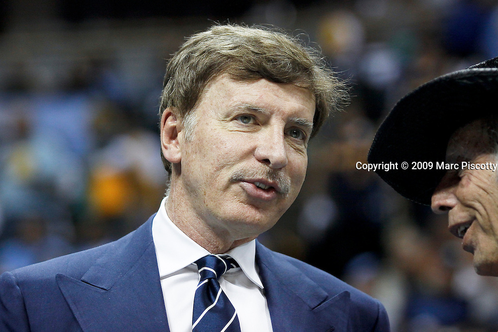 Denver Nuggets' owner Stan Kroenke (left) talks with NBA superfan Jimmy Goldstein (right) prior to the start of Game 4 of the NBA Western Conference Finals in Denver, Co. May 25, 2009. Kroenke is also majority shareholder of the English football team Arsenal and his wealth is estimated to be about $3.5 billion and based primarily on real estate..(Photo by Marc Piscotty / © 2009)
