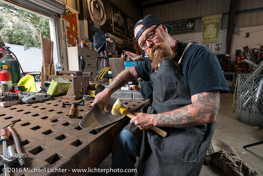 Bill Dodge hammers a gas tank side panel by hand in his Blings Cycles shop during Daytona Bike Week 75th Anniversary event. FL, USA. Friday March 4, 2016.  Photography ©2016 Michael Lichter.