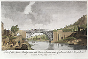 Abraham Darby III's iron bridge across the Severn at Ironbridge, Coalbrookdale, England. First iron bridge in world, built between 1776 and 1779. In front of left abutment are 4 'hobblers' pulling a boat. Engraving.