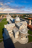 Aerial view of the Romanesque Duomo of Pisa . Pisa Cathedral is a medieval Roman Catholic cathedral dedicated to the Assumption of the Virgin Mary, in the Piazza dei Miracoli in Pisa, Italy. It is a notable example of Romanesque architecture, in particular the style known as Pisan Romanesque.It is the seat of the Archbishop of Pisa. Construction on the Pisa cathedral began in 1063, in the early 12th century the cathedral was enlarged under the direction of architect Rainaldo.