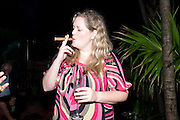 CLARE COOMBS SMOKING DOMINICAN CIGSR, Jay Jopling hosts a party at Soho House. Miami Beach. Miami art Basel. 30 November 2010. -DO NOT ARCHIVE-© Copyright Photograph by Dafydd Jones. 248 Clapham Rd. London SW9 0PZ. Tel 0207 820 0771. www.dafjones.com.
