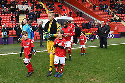 Charlton Athletic and Fleetwood Town players enter the pitch