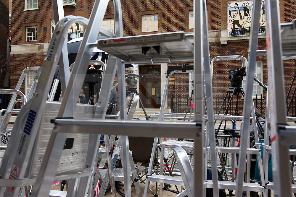 © Licensed to London News Pictures. 04/07/2013. London, UK. The entrance to the Lindo Wing of St Mary's Hospital in West London is seen through stepladders belonging to the media today (04/07/2013) as the world awaits the arrival of the son or daughter of the Duke and Duchess of Cambridge. Photo credit: Matt Cetti-Roberts/LNP