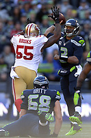National Footbal League NFL USA<br /> 14.12.2014<br /> Foto: imago/Digitalsport<br /> NORWAY ONLY<br /> <br /> Seattle Seahawks Quarterback Russell Wilson (3) battles with San Francisco 49ers Linebacker Ahmad Brooks (55) in action during a game between the San Francisco 49ers and the Seattle Seahawks at CenturyLink Field, in Seattle,WA.