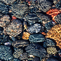 """""""A Stones Throw"""" 4<br /> <br /> The underwater glimmer and ripples ride over beautiful Lake Superior stones from the bright sun shining above!!<br /> Brilliant colors of blue, yellow, red, pink, and gray sparkle in the shallow waters!!<br /> <br /> Nature Abstracts by Rachel Cohen"""
