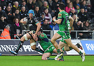 Ospreys' Justin Tipuric is tackled by Connacht's Dennis Buckley.<br /> <br /> Guinness Pro12 rugby match, Ospreys v Connacht rugby at the Liberty Stadium in Swansea, South Wales on Saturday 7th January 2017.<br /> pic by Craig Thomas, Andrew Orchard sports photography.