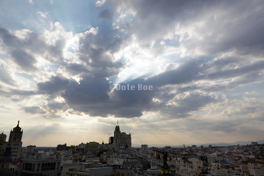 center of Madrid with dramatic cloud during sunset