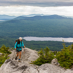 A teenage girl on Moxie Bald Mountain. Moxie Pond is in the distance. Appalachian Trail. Bald Mountain Township, Maine.