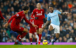 Liverpool's Virgil van Dijk (left) and Manchester City's Raheem Sterling battle for the ball during the Premier League match at the Etihad Stadium, Manchester.