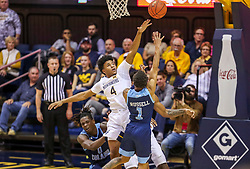 Dec 1, 2019; Morgantown, WV, USA; West Virginia Mountaineers guard Miles McBride (4) defends a shot from Rhode Island Rams guard Fatts Russell (1) during the second half at WVU Coliseum. Mandatory Credit: Ben Queen-USA TODAY Sports
