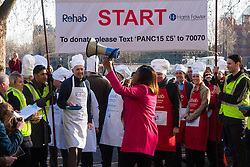 London, February 17th 2015. Members of Parliament put their dignity aside for a bit of fun as they compete in the annual Parliamentary Pancake Race in Victoria Tower Gardens adjacent to the House of Lords.  PICTURED: ITV's Charlene Wright gets the racers ready at the start.