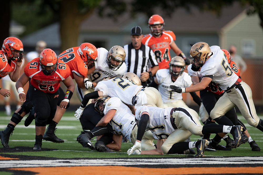 Penn defenders swarm to the ball to make the tackle during the Penn-LaPorte high school football game on Friday, August 28, 2020, at Kiwanis Field in LaPorte, Indiana.