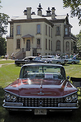 03 August 2013:  The David Davis Mansion serves as a backdrop for an antique car show.  In the foreground is a 1959 Buick Invicta.<br /> <br /> Displayed at the McLean County Antique Automobile Association Car show at David Davis Mansion in Bloomington Illinois