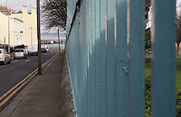 Blue park railings at the seaside town of DunLaoghaire in Dublin Ireland