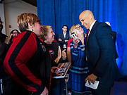 05 DECEMBER 2019 - DES MOINES, IOWA: US Senator CORY BOOKER (D-NJ), right, talks to VIP guests at his rally after he finished his formal speech in Des Moines Friday. He talked about the need to reunify the country. Senator Booker is running to be the Democratic nominee for the US Presidency in 2020. Iowa hosts the first selection event of the presidential election season. The Iowa caucuses are February 3, 2020.      PHOTO BY JACK KURTZ