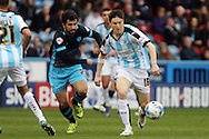 Alex Lopez of Sheffield Wednesday (l) and Joe Lolley of Huddersfield Town (r) chase the ball. Skybet football league Championship match, Huddersfield Town v Sheffield Wednesday at the John Smith's Stadium in Huddersfield, Yorkshire on Saturday 2nd April 2016.<br /> pic by Chris Stading, Andrew Orchard sports photography.