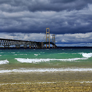 """""""Rolling with the Mack""""<br /> <br /> The beautiful Mackinac Bridge crossing over the straits of Mackinac. Layers of clouds, and colors of water in all hues of blue!!<br /> <br /> Mackinac Bridge by Rachel Cohen"""