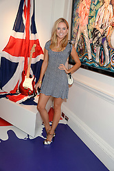 KIMBERLY GARNER at Ronnie Wood's Raw Instinct Summer Party held at Castle Fine Art, Bruton Street, London on 9th July 2013.