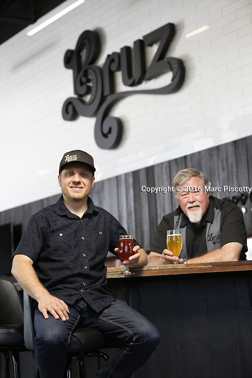 SHOT 7/22/16 1:48:33 PM - Bruz Beers co-founders Charlie Gottenkieny and Ryan Evans inside the new brewery near 67th Avenue and Pecos in Denver, Co. Bruz Beers is Denver's artisanal Belgian-style brewery, featuring a full line of traditional and Belgian-inspired brews, hand-crafted in small batches. Includes images of Evan's dog 'Cooper' as well who serves as the brewery dog. (Photo by Marc Piscotty / © 2016)