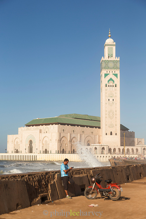 Man with motorcycle near Hassan II Mosque in Casablanca, Morocco