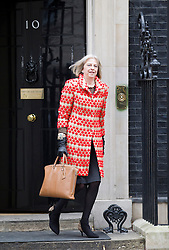 © Licensed to London News Pictures. 07/01/2013. London, UK. The Home Secretary Theresa May is seen on Downing Street in London today (07/01/13) after attending the first cabinet meeting of 2013. Photo credit: Matt Cetti-Roberts/LNP