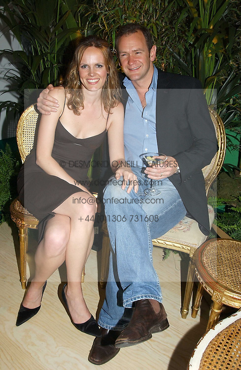 Actor XANDER ARMSTRONG and his wife ANNA at a party to celebrate the launch of the new Matthew Williamson fragrance held at Harvey Nichols, Knightsbridge, London on 14th June 2005.<br /><br />NON EXCLUSIVE - WORLD RIGHTS