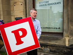 """Pictured: Willie Rennie dying for a p<br /> <br /> Scottish Liberal Democrat leader Willie Rennie made his final pitch for votes today as he unveiled large building blocks that spelt out the party's flagship """"Penny for education"""" policy. Scottish Liberal Democrats HQ, 4, EH12 5DR. Adam Clarke 07450 980 386.the election on Thursday.<br /> <br /> Ger Harley 