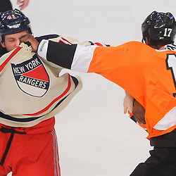 Philadelphia Flyers right wing Wayne Simmonds (17) fights New York Rangers defenseman Stu Bickel (41) during first period NHL action between the Philadelphia Flyers and the New York Rangers at Madison Square Garden in New York, N.Y. The Rangers lead 1-0 at the first intermission.