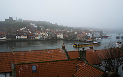 © Licensed to London News Pictures. 03/04/2014<br /> <br /> Whitby, North Yorkshire, United Kingdom<br /> <br /> Heavy fog shrouds the North Yorkshire seaside town of Whitby as a boat heads out to sea.<br /> <br /> Photo credit : Ian Forsyth/LNP