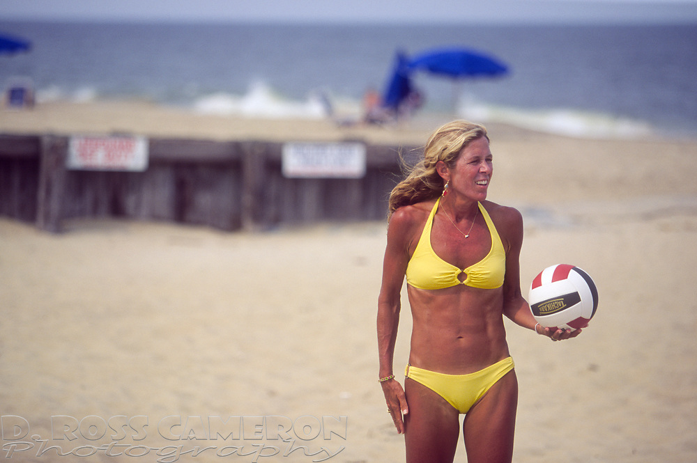 Ann S. Cameron of Edmond, Okla. prepares to serve during a game of beach volleyball at Henlopen Acres Beach Club, Wednesday, July 31, 2013 in Rehoboth Beach, Del. (Photo by D. Ross Cameron)