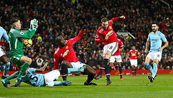 Manchester United's Juan Mata has an attempt at goal saved by Manchester City goalkeeper Ederson during the Premier League match at Old Trafford, Manchester.