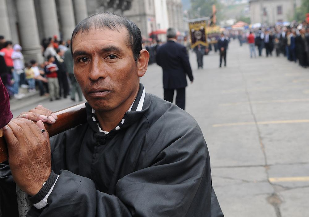 Apr 21, 2011 - Quetzaltenago, Guatemala - A member of the Nazarene brotherhood holding up one end of a float..(Credit Image: © Josh Bachman/ZUMA Press)