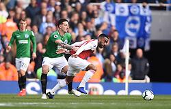 Brighton & Hove Albion's Lewis Dunk fouls Arsenal's Alexandre Lacazette