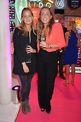 Left to right, ROSE McGOWAN and AMY BELL at Light Up Your Life - a party hosted by Lillingston held at Lights of Soho, 35 Brewer Street, London on 1st October 2015.