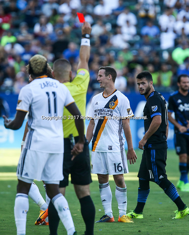 Los Angeles Galaxy Nathan Smith (16) receives a red card from the referee during an MLS soccer match against San Jose Earthquakes Sunday, August 27, 2017 in Los Angeles. The Earthquakes Won 3-0.(Photo by Ringo Chiu)<br /> <br /> Usage Notes: This content is intended for editorial use only. For other uses, additional clearances may be required.