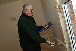 Housing Association Officer tests a property for damp in a flat; York