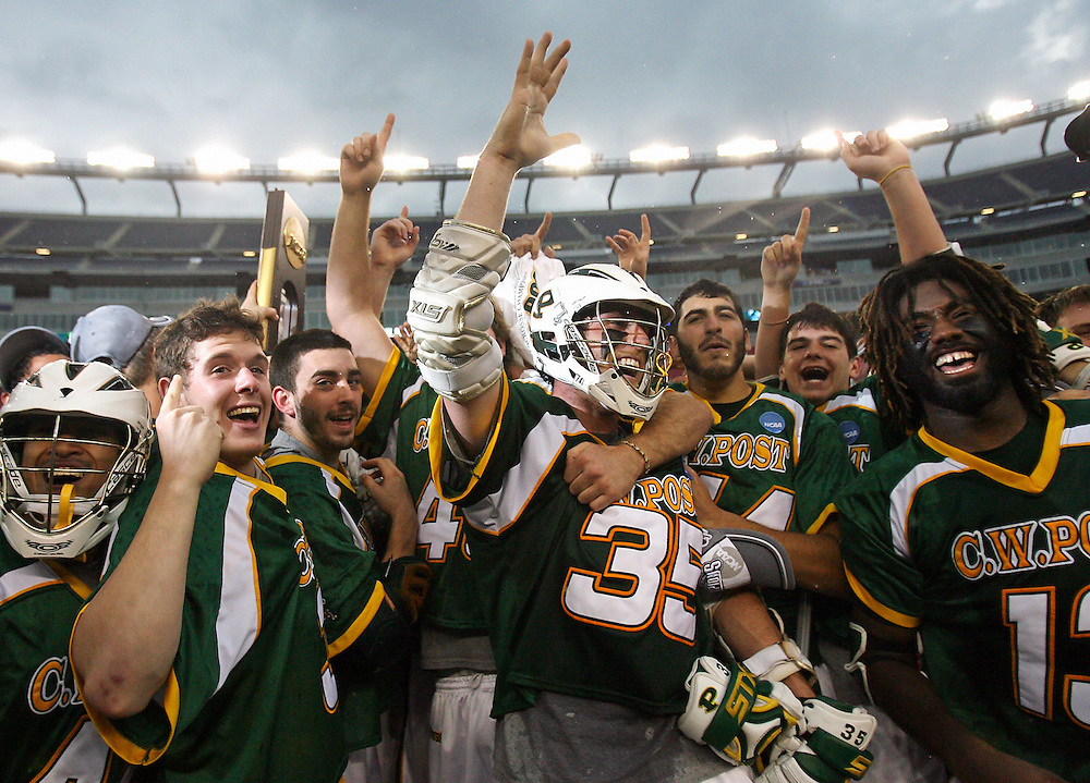 (052409 Foxboro, MA)  CW Post cheers after winning their NCAA Division I championship game held at Gillette Stadium.