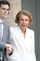 File photo - Liliane Bettencourt and Martin d'Orgeval pose in the courtyard of the Elysee Palace in Paris, France on July 3, 2008, prior to attend a ceremony awarding designer Giorgio Armani, actress Claudia Cardinale and singer Tina Turner with France's most prestigious Legion d'Honneur medal by French President Nicolas Sarkozy. Liliane Bettencourt has died aged 94 it was announced on September 21, 2017. Bettencourt was the richest person in France and the third-richest woman in the world with a net worth of $40 billion. She was the sole heir to L'Oreal, the largest cosmetics company in the world, which was started by her father, and a large shareholder in Nestle. Nearly a decade ago a trial forced Liliane's personal business into the public light, laid bare her obsession with a flashy homosexual photographer whom she turned into a billionaire, destroyed her relationship with her daughter, turned a long time family butler against her, and, finally, turned the dowager heiress into even more of a recluse than she had been before. Photo by Orban-Taamallah/ABACAPRESS.COM