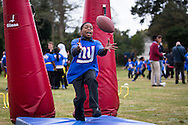 New York Giants entertain kids during the New York Giants Press Day at Syon House, Brentford, United Kingdom on 21 October 2016. Photo by Jason Brown.