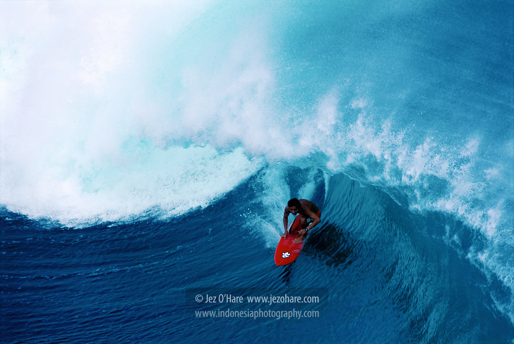 Surfing at Uluwatu, Bali, Indonesia.