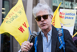 London, UK. 26th February, 2019. George Binette from Hackney North Labour Party addresses mainly migrant striking outsourced workers belonging to the Independent Workers of Great Britain (IWGB), United Voices of the World (UVW) and Public and Commercial Services Union (PCS) trade unions working at the University of London (IWGB), Ministry of Justice (UVW) and Department for Business Energy and Industrial Strategy (PCS), together with representatives of the National Union of Rail, Maritime and Transport Workers (RMT) Regional Council, taking part in a 'Clean Up Outsourcing' demonstration to call for an end to the practice of outsourcing. The demonstration was organised to coincide with a significant High Court hearing of an application by the IWGB for judicial review of a decision by the Central Arbitration Committee (CAC) not to hear their application for trade union recognition for the purposes of collective bargaining with the University of London.