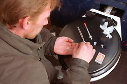Homeless man preparing to use heroin,