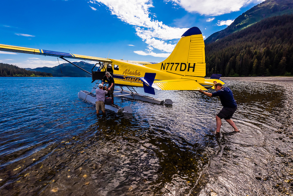 Alaska Seaplanes plane landing at Pack Creek on Admiralty Island, Inside Passage, Southeast Alaska USA.