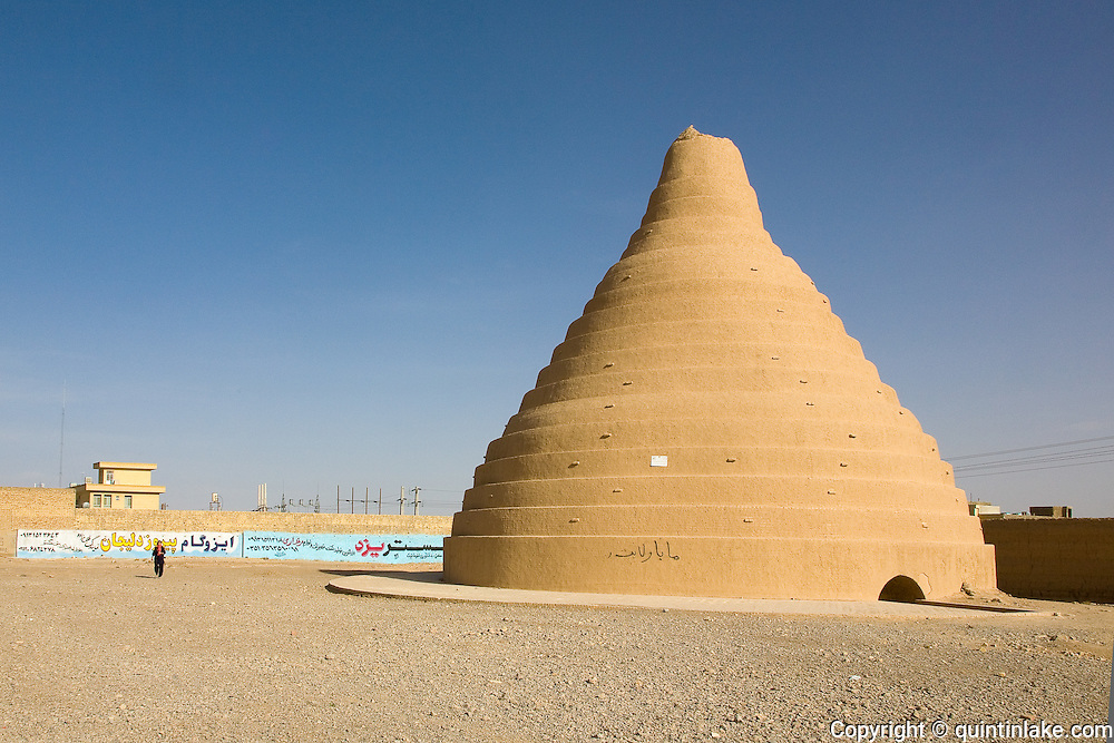 An ice house or Yakhchal, an ancient refrigerator allowing the storage of ice in.the desert in summer. It was collected in winter and kept cool by its shape and walls.made from special mortar called s_rooj, composed of sand, clay, egg whites, lime,.goat hair, and ash, which was resistant to heat transfer. Abarqu, Iran, 2008